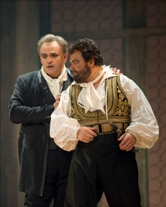 Act 3: Iago (Todd Thomas) promises Otello (Kristian Benedikt) that he will provide proof of Desdemona's infidelity: Otello is to hide and listen as Iago gossips with Cassio. Image courtesy of Pacific Opera Victoria