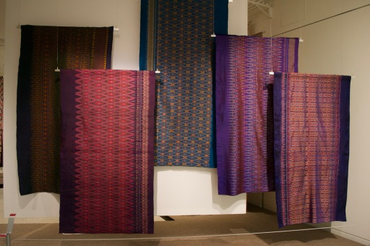 A recent collection from Thailand. These pieces are tye-dyed before the weaving process. Layers of Influence exhibtion, MOA at UBC Photo cred: Lauren Chancellor