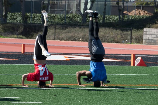 Becca and Christon have a little fun while not running drills.