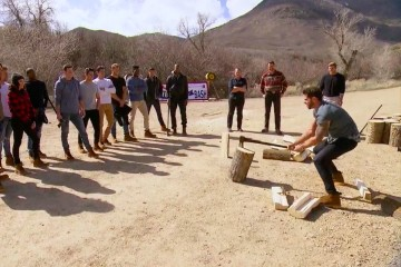 The men practice chopping wood before the competition